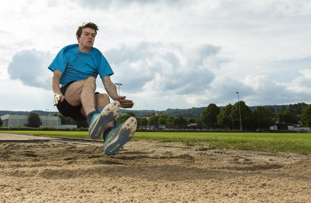 The length of a long jump is determined by where a jumper lands in a sandpit.