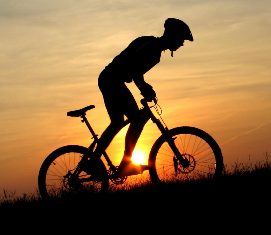 Biking is a low-impact exercise that can be done outdoors or inside on a stationary bicycle.