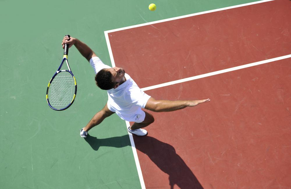 The movement of the body and arm are very important in a tennis serve.