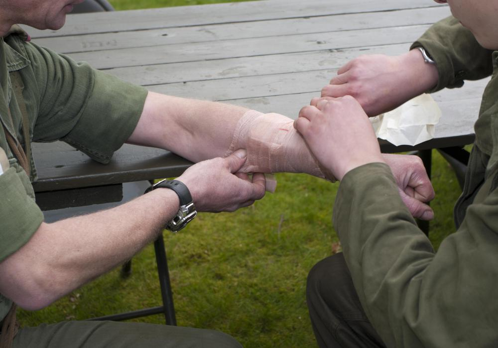 A military medic is responsible for changing dressing on wounds.