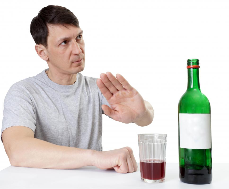 A sober driver doesn't drink at a gathering with others who are drinking.