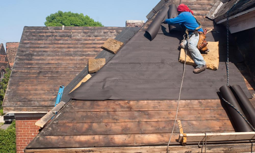 Roofers May Wear A Safety Harness.