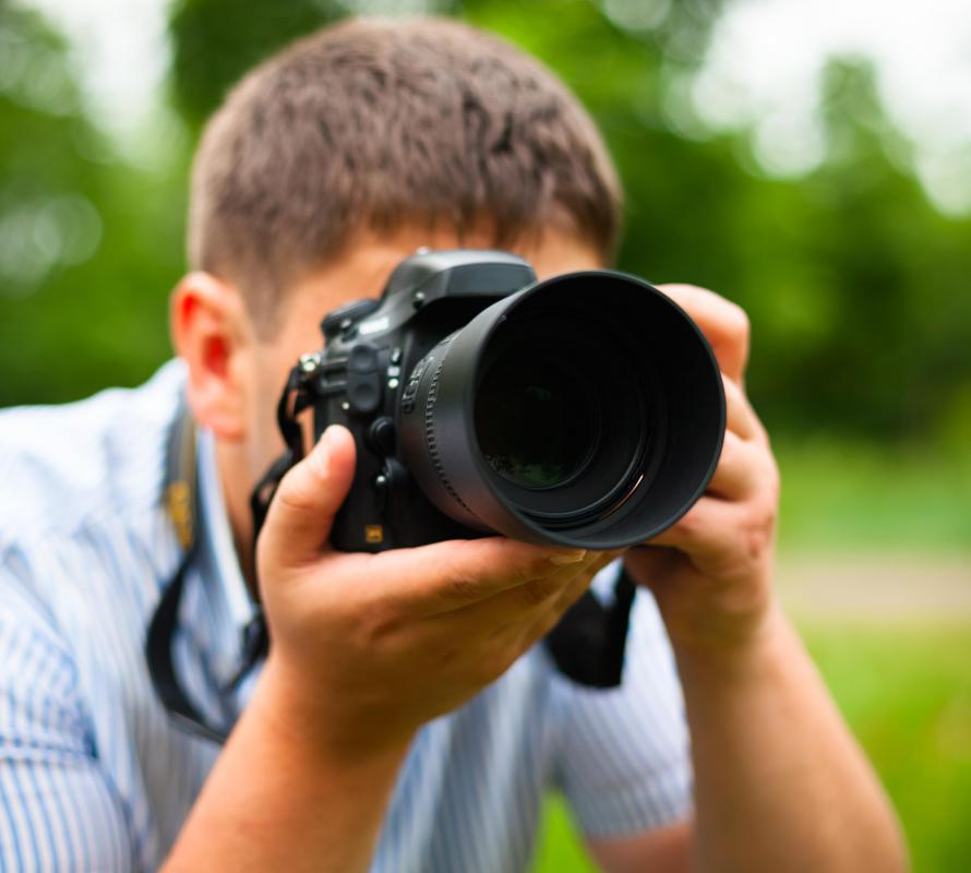A DSLR camera has a detachable lens.