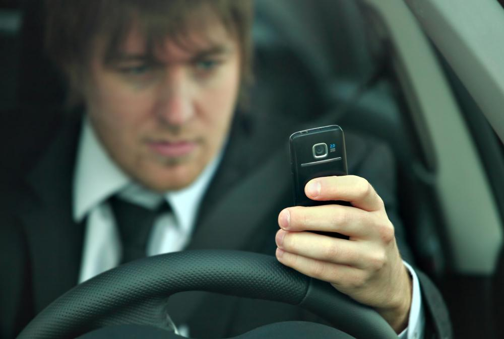 Someone texting while driving might be fined for distracted driving.