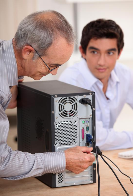 A person can ground themselves while working on a computer, and thus avoid damaging a motherboard with static electricity, by first touching the metal frame of the computer's tower.