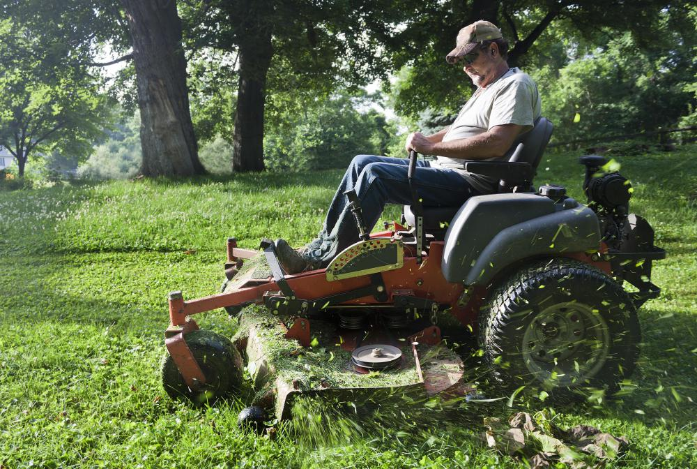 Man Riding Lawn Mower : What are the different types of lawn mower tools