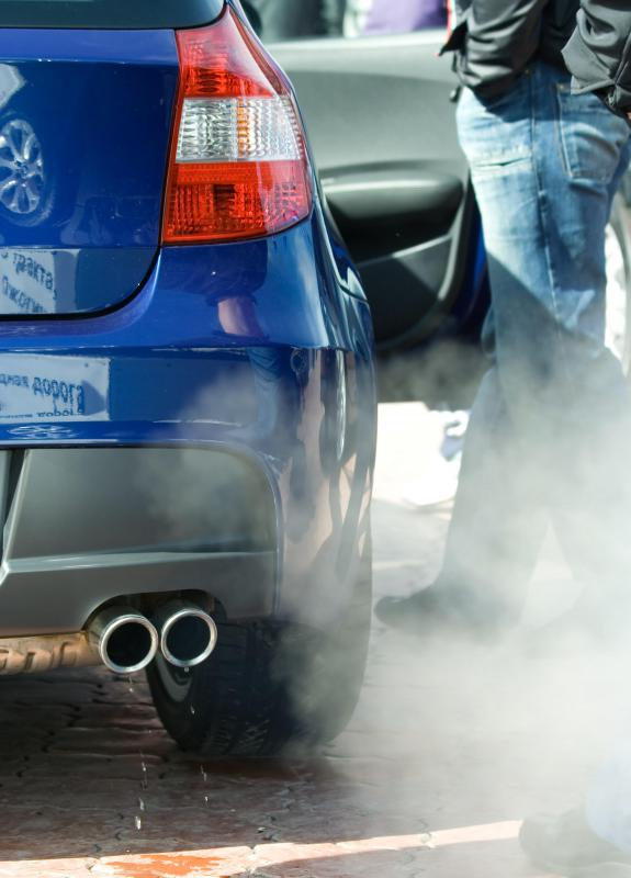 Man With Blue Car And Exhaust Fumes on Car Pipe Exhaust Fumes