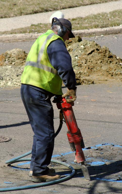 Jackhammers may be powered by fluid or air.