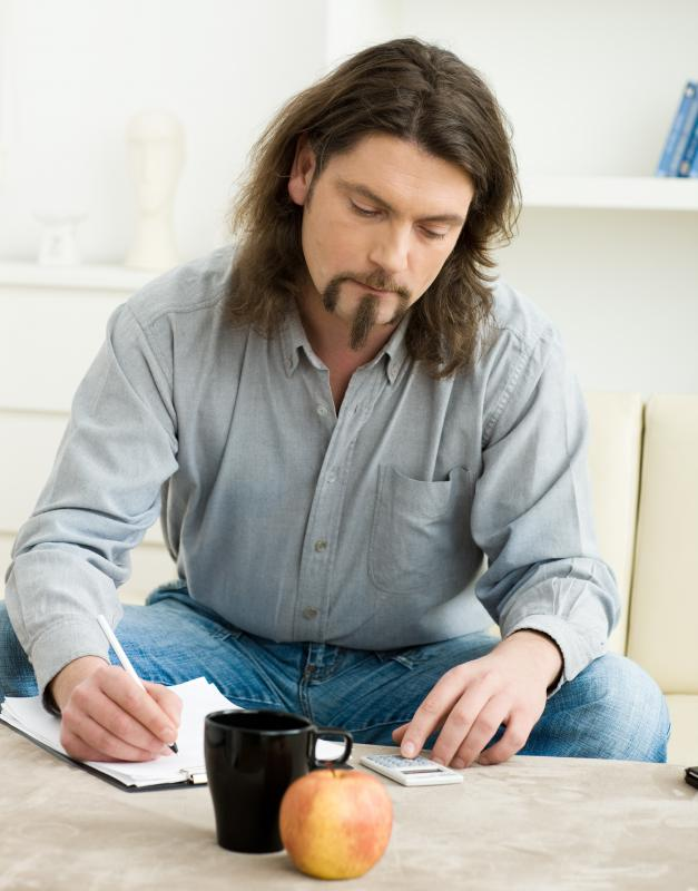 A man filling out a budget health insurance application.