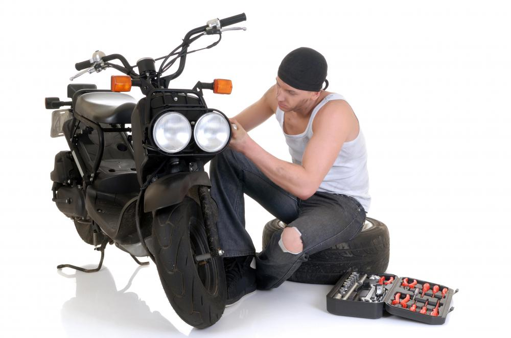 Man working on motorcycle.