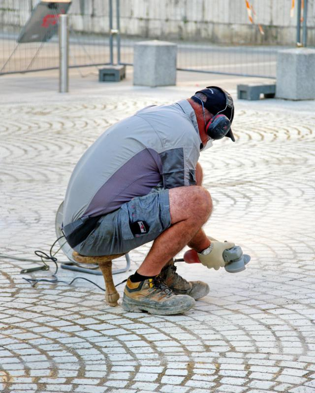 Since they must be laid out in a precise manner and may have to be shaped to fit a particular location, cobblestones are usually laid out by tradesmen.