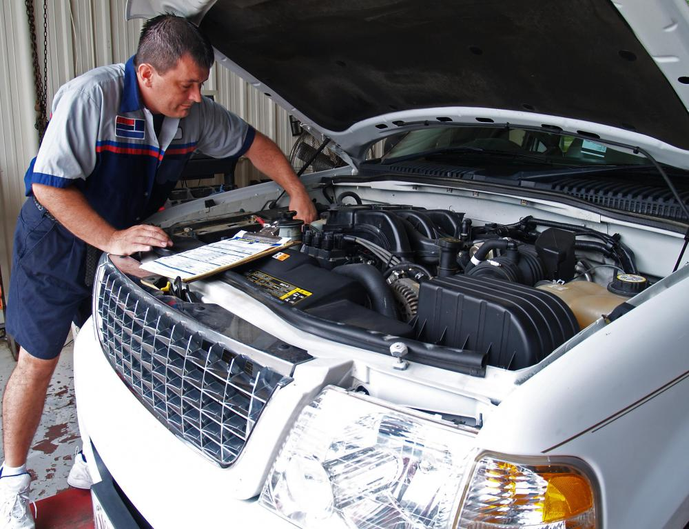 Auto shop mechanics can assist with changing brake fluid.