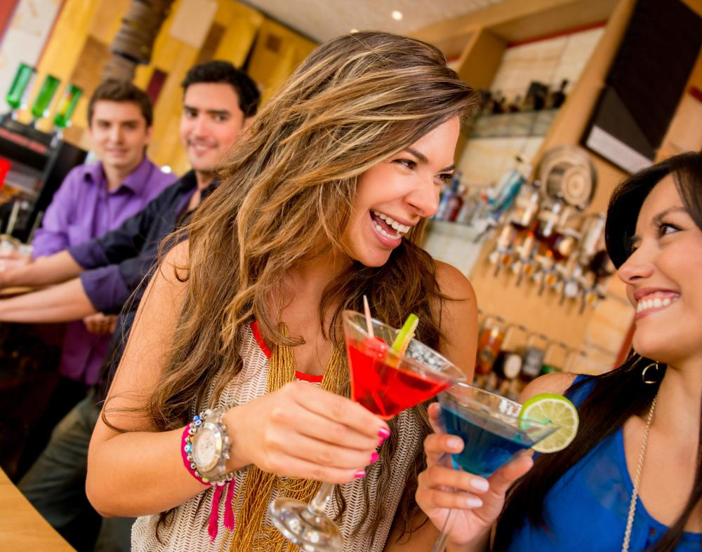 Socializing at bars is one way to meet new people and meet new friends.