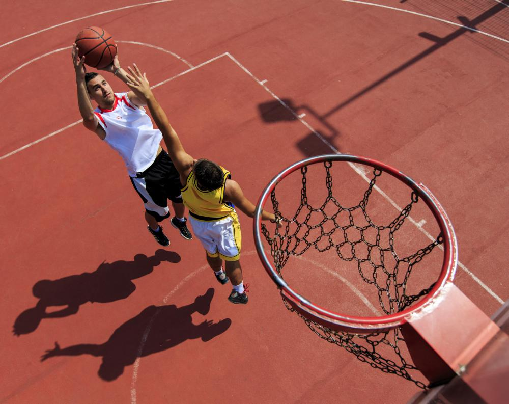 A therapeutic basketball camp may help young people develop their physical skills.