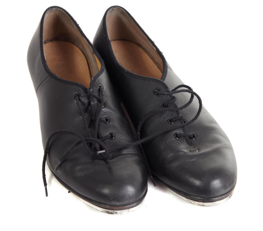 Formal attire for men may consist of black, polished shoes.
