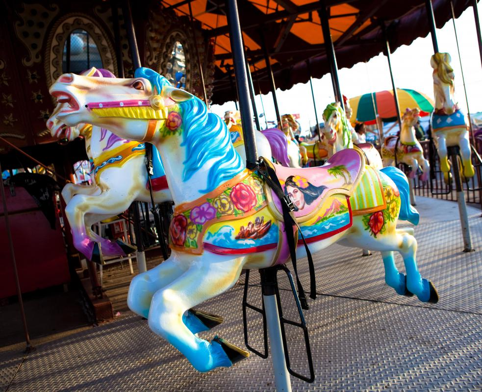 The seating on merry-go-rounds usually consists of carved animals.