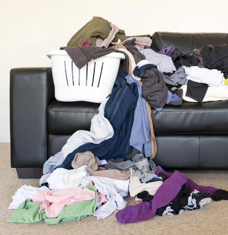 Using a laundry sorter can help keep a large volume of laundry from becoming overwhelming,.