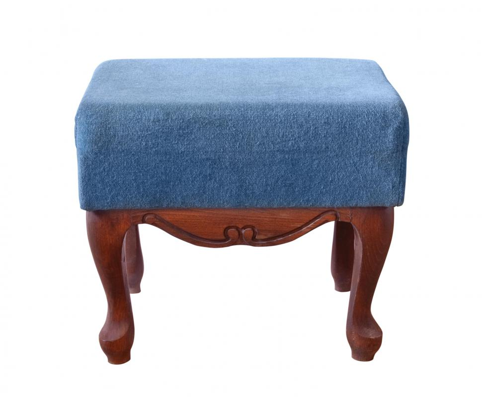 An upholstered footstool.