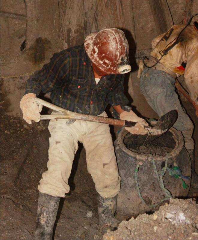 Mining work includes hard physical labor.