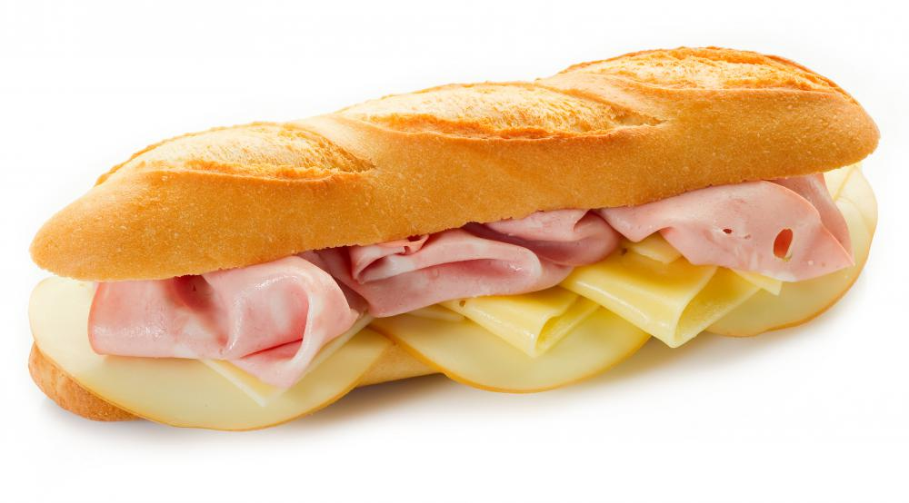 A sandwich with lunch meat and cheese.
