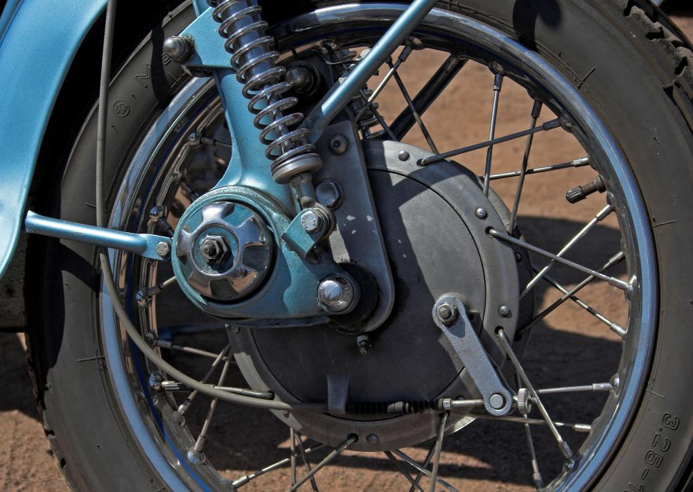 Many shops have machines that assist in wheel changes for motorcycles.