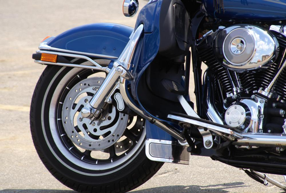 Motorcycles have fenders to keep dirt out of its wheels.
