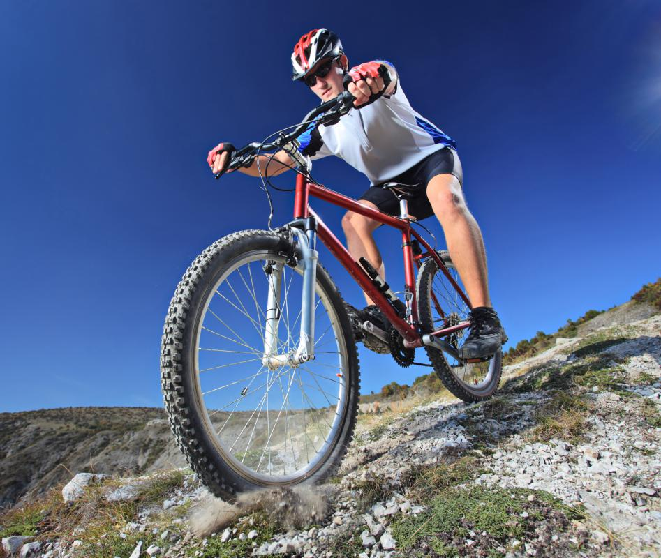 A bicycle tour may involve mountain biking.