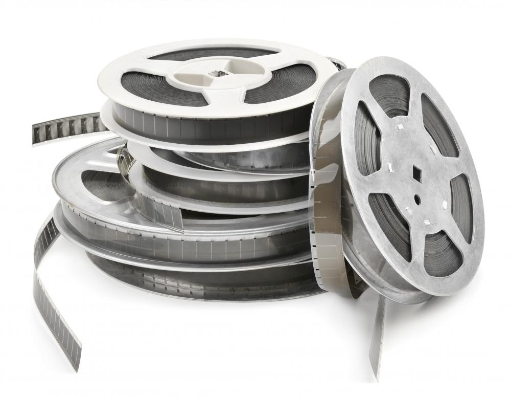 Mounting film reels on the wall can create a unique decor for a media room.