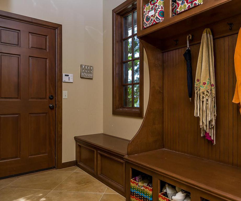 Benches, shelves and books make mud rooms more useful.