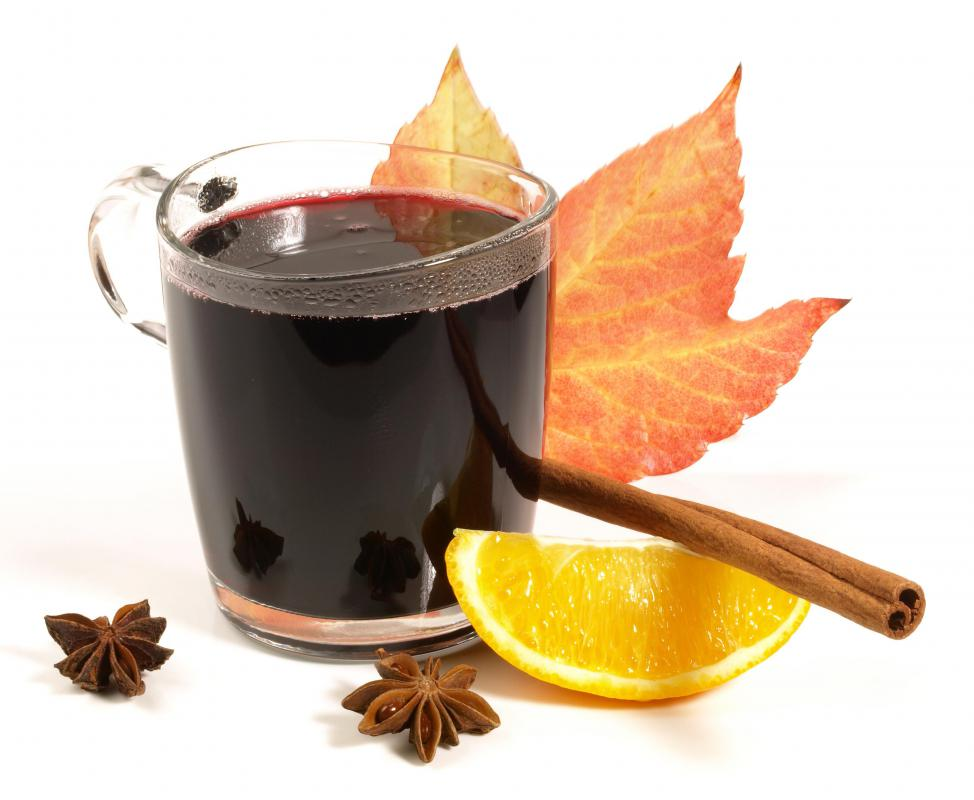 Mulled wine with a fall maple leaf.