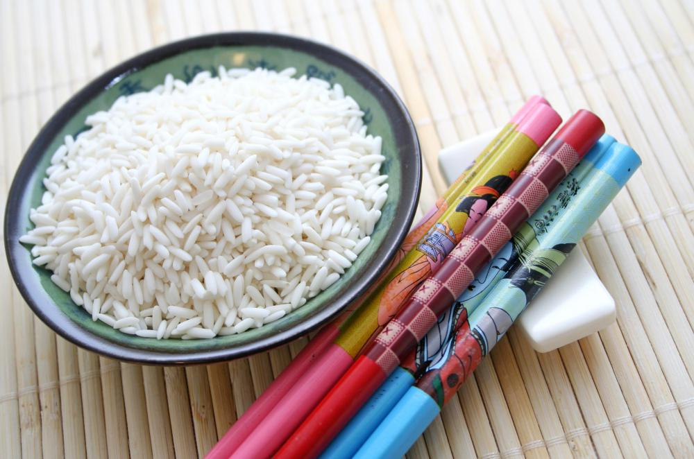 In China it is conventional to pick up a rice bowl and use chopsticks to shovel rice to the mouth.