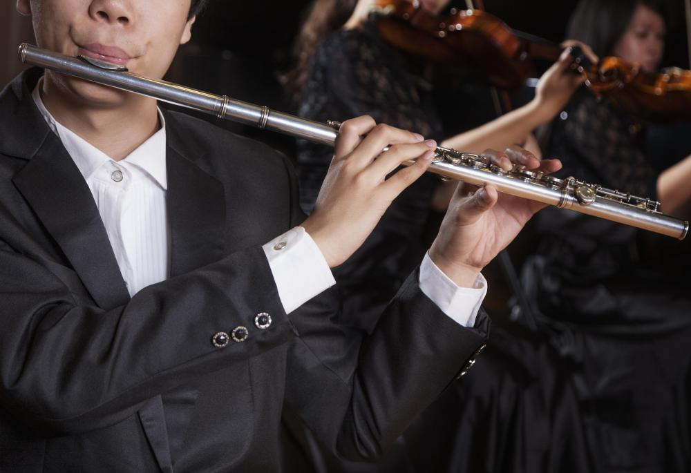 Wind orchestras usually prominently feature woodwind instruments, such as flutes.