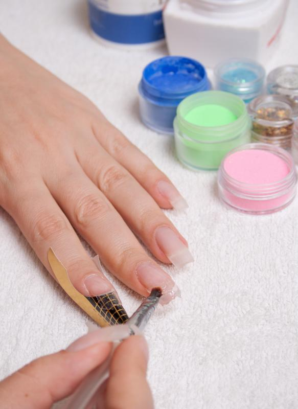 Acrylic nail powder is commonly applied in salons to create acrylic nails.