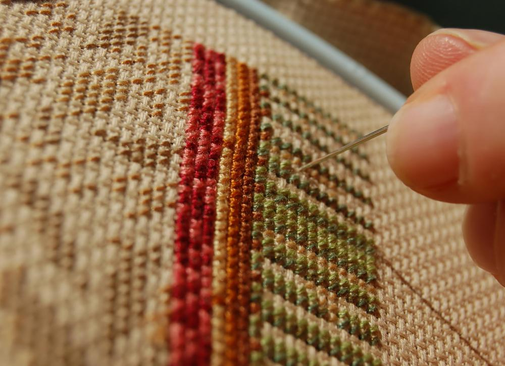 Crafts, like needlepoint, can help adults maintain fine motor skills.