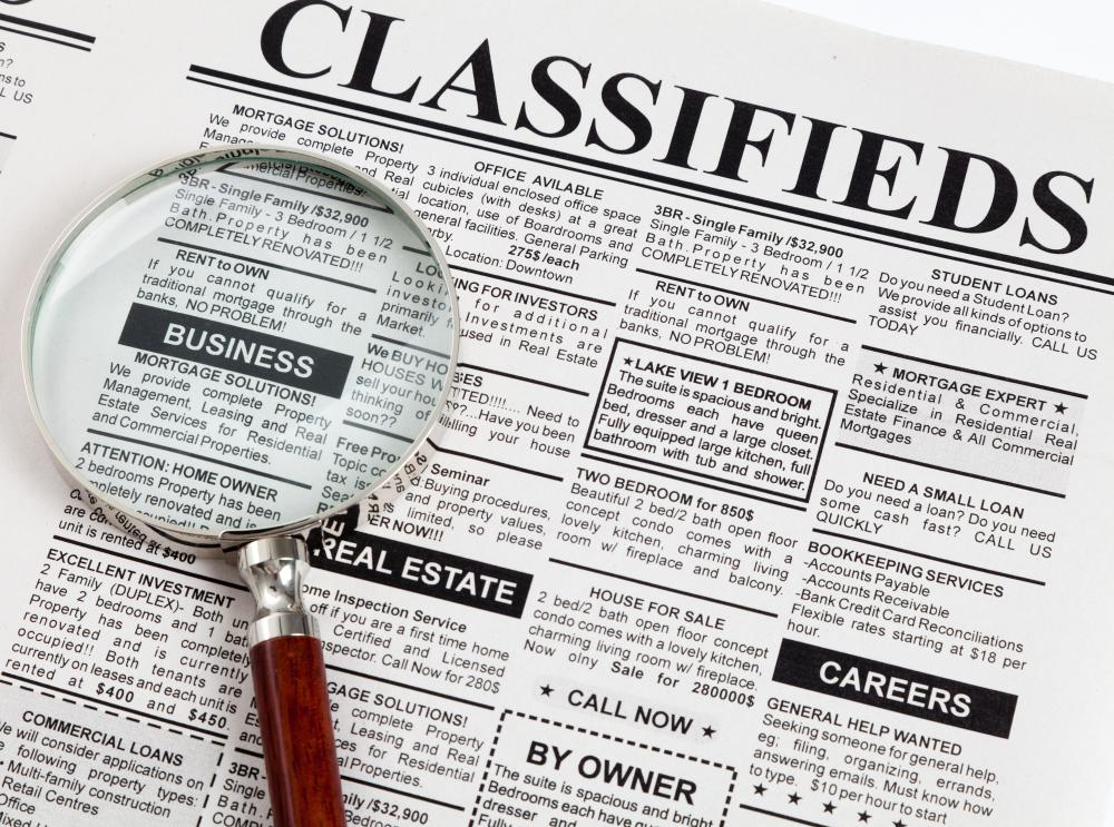 A frugal shopper may often peruse the classifieds in a newspaper.