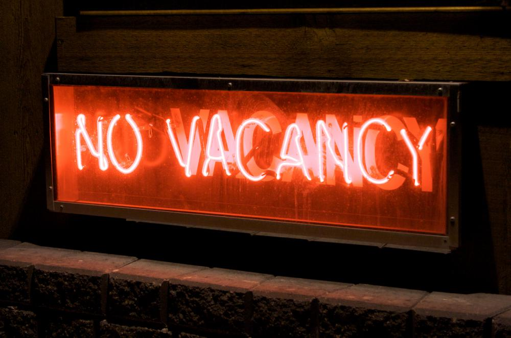 No-vacancy signs, often seen at motels, alert prospective guests to the lack of available lodging.