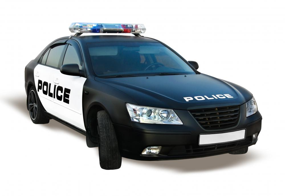 Most police departments use cars that are equipped with radios to patrol urban areas.