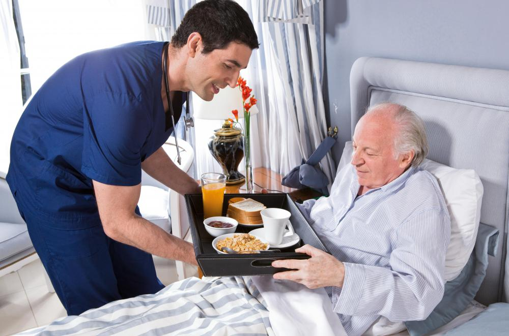 Hospital tables are commonly used to hold food trays.