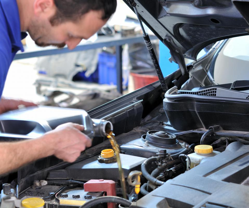 Auto mechanics perform maintenance and repairs.