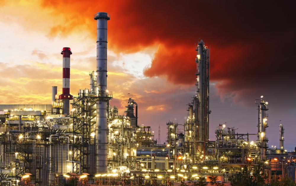 Raw fossil fuels are processed in refineries.