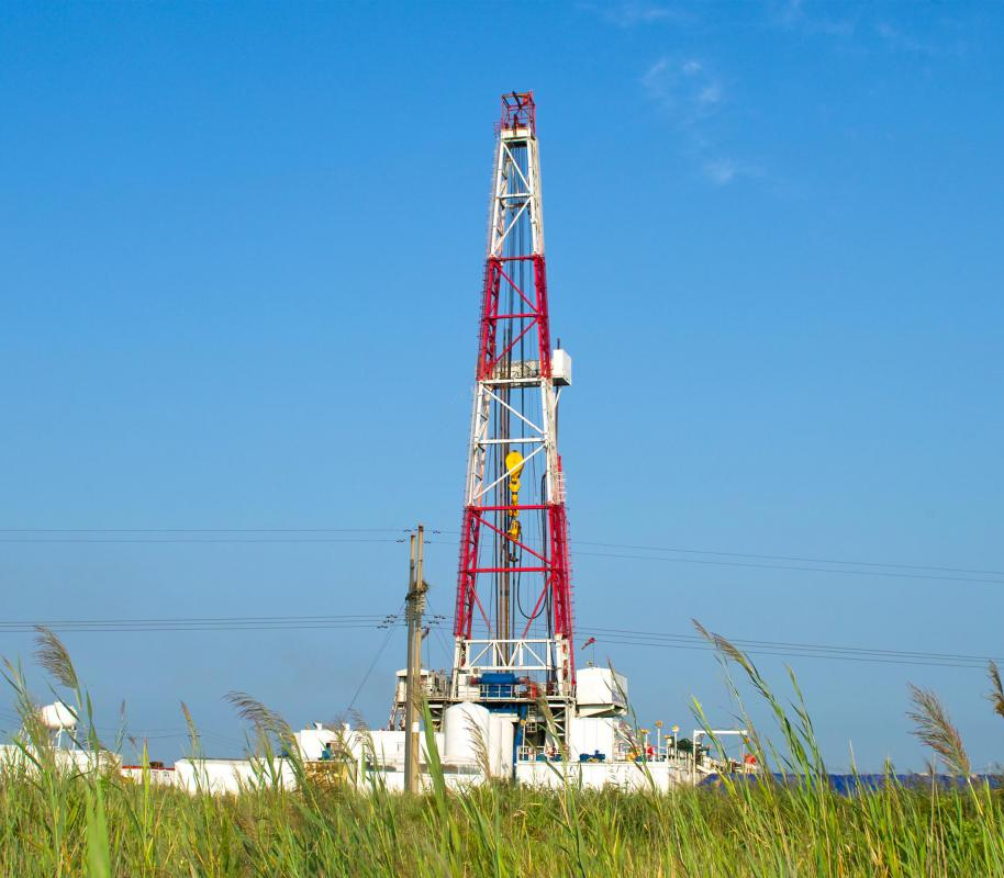 A drill rig is used to drill for oil. Crude oil can be refined into heating oil and other petroleum products.
