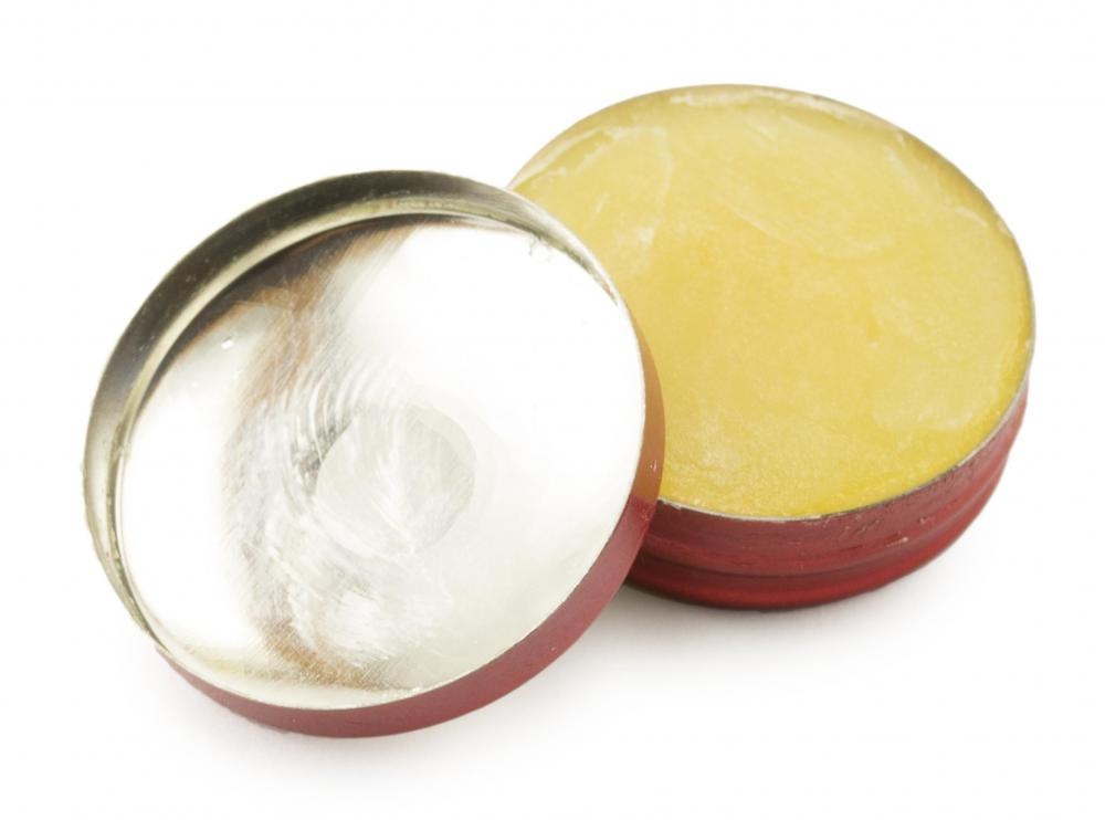 Salve, which typically comes in a tin container and contains waxes and oils, can be used to treat dry and chap lips and skin.