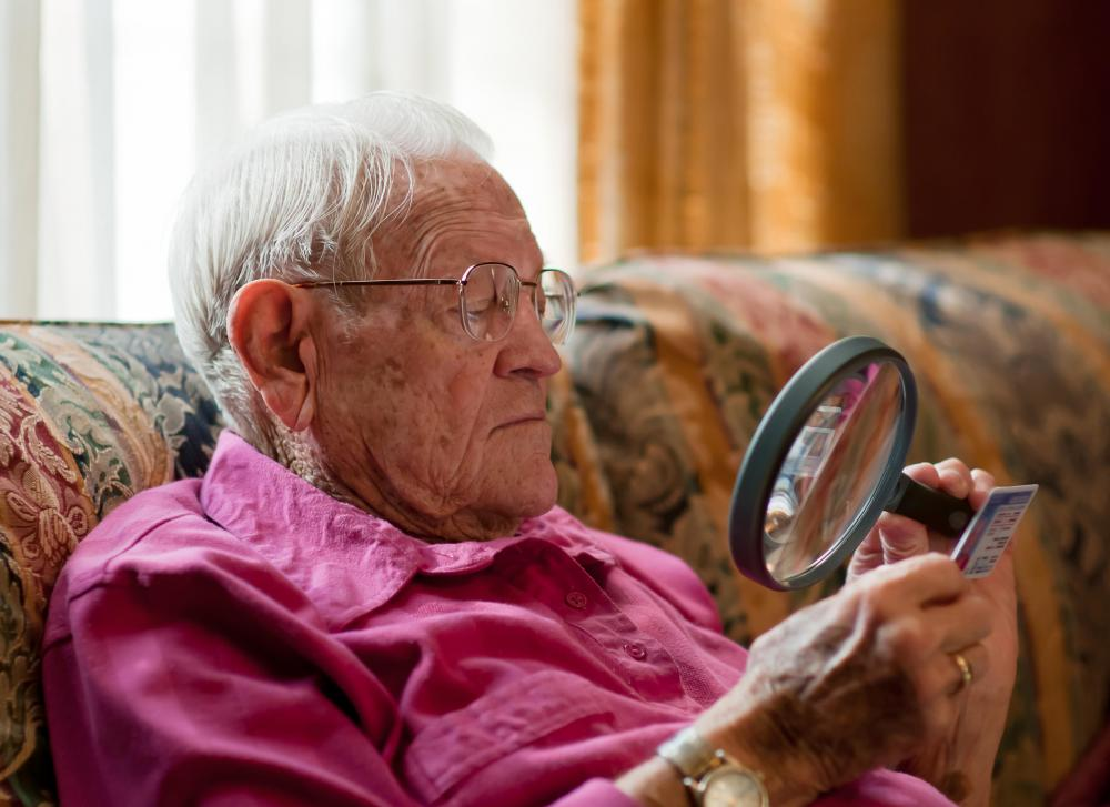 old-man-in-pink-shirt-with-magnifying-glass.jpg