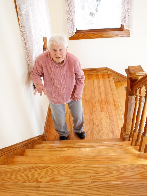 elderly woman out of breath on stairs