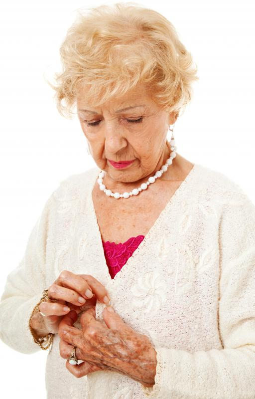 An individual suffering from arthritis may have difficulty performing basic tasks such as getting dressed.