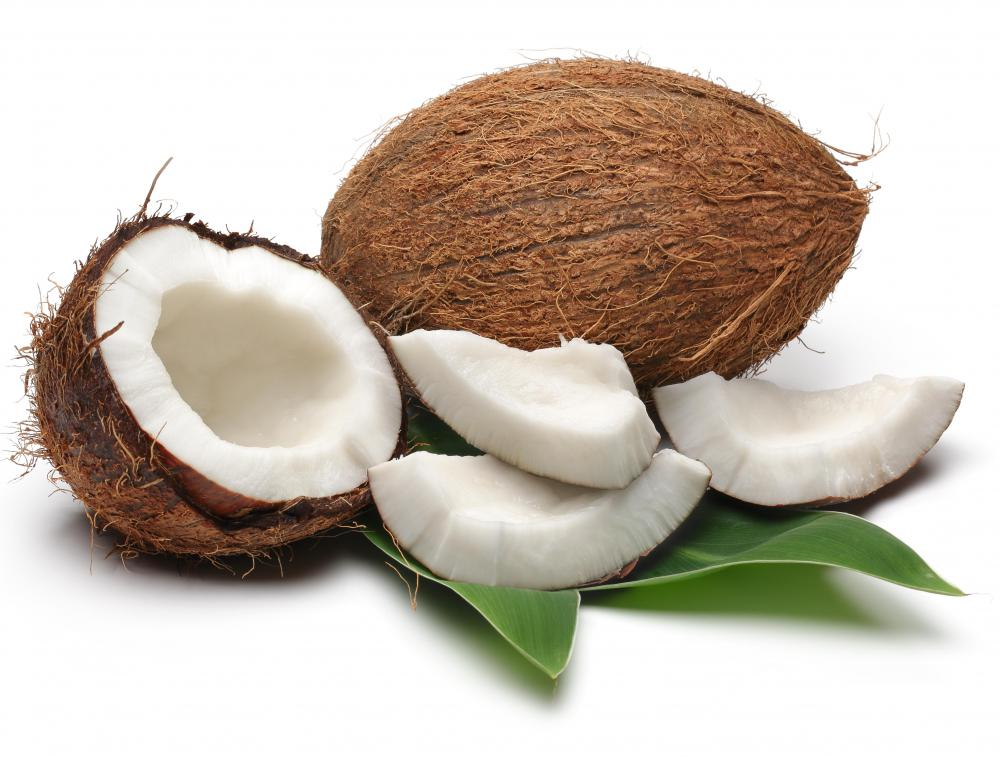 A coconut has a hard shell encased in a fibrous outer layer with a fleshy, white inside.