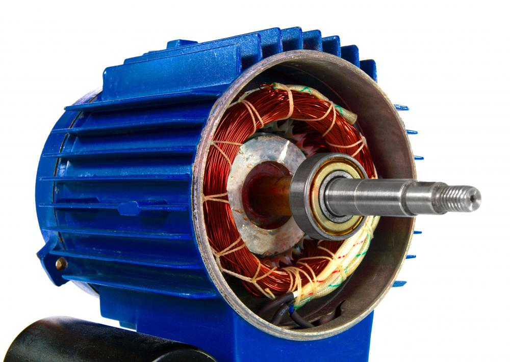 In an electric motor, the application of electricity to a magnet causes it to rotate within a metal housing.