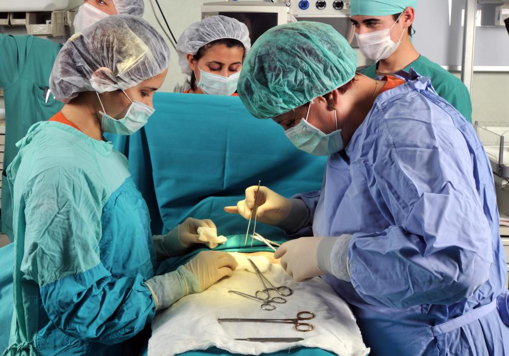 In a sleeve gastrectomy, the patient's vital signs are carefully monitored by a team of surgical assistants.