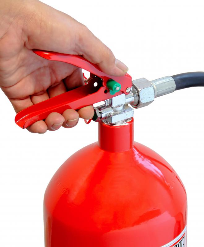 Learning how to use a fire extinguisher is part of fire warden training.