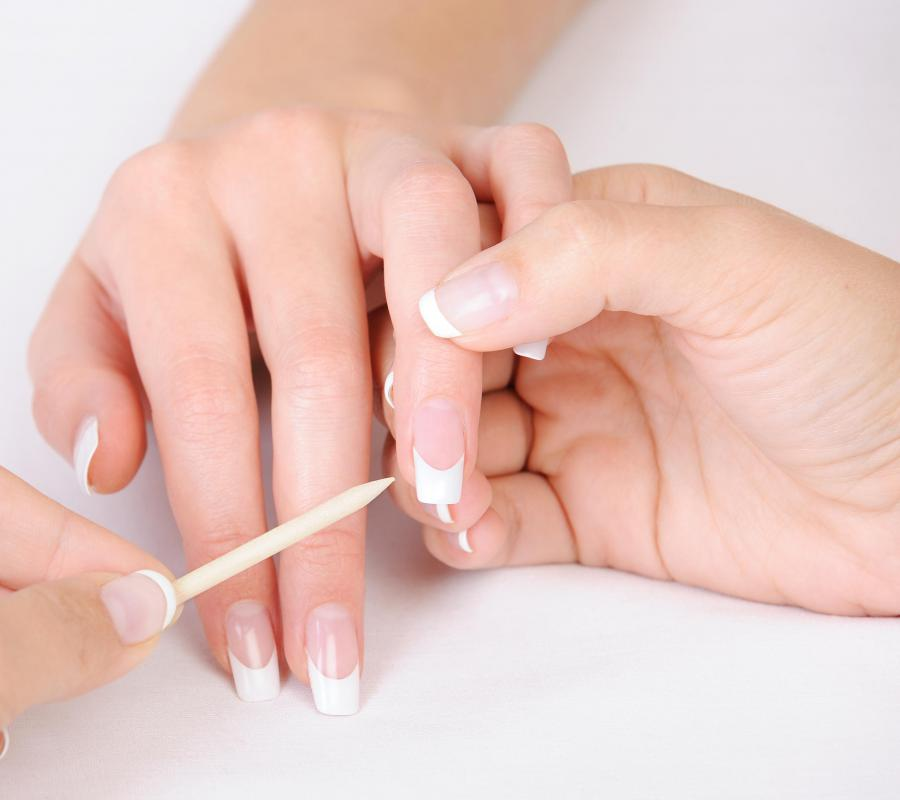 Wooden nail sticks may be used to gently push back cuticles.